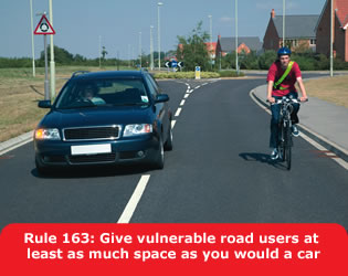 Car overtaking a bicycle, leaving 8 feet of space.